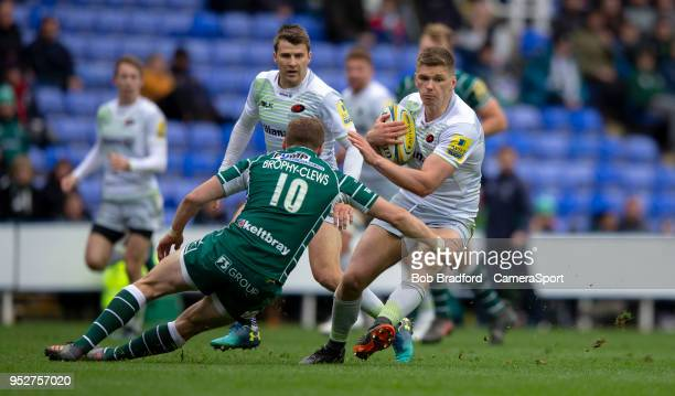 Saracens' Owen Farrell evades the tackle of London Irish's Theo Brophy Clews during the Aviva Premiership match between London Irish and Saracens at...