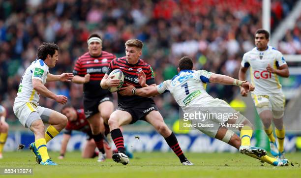 Saracens Owen Farrell gets past Clermont's Damien Chouly during the Heineken Cup Semi Final match at Twickenham London