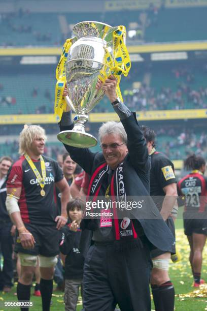 Saracens' owner Nigel Wray holds aloft the trophy following the AVIVA Premiership Final between Leicester Tigers and Saracens at Twickenham Stadium...