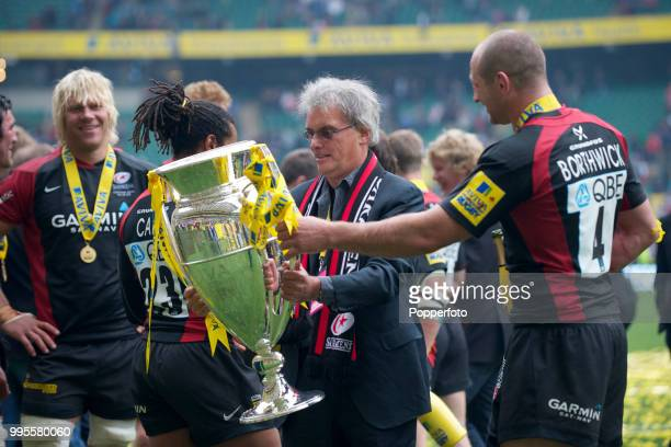 Saracens' owner Nigel Wray holds the trophy following the AVIVA Premiership Final between Leicester Tigers and Saracens at Twickenham Stadium in...