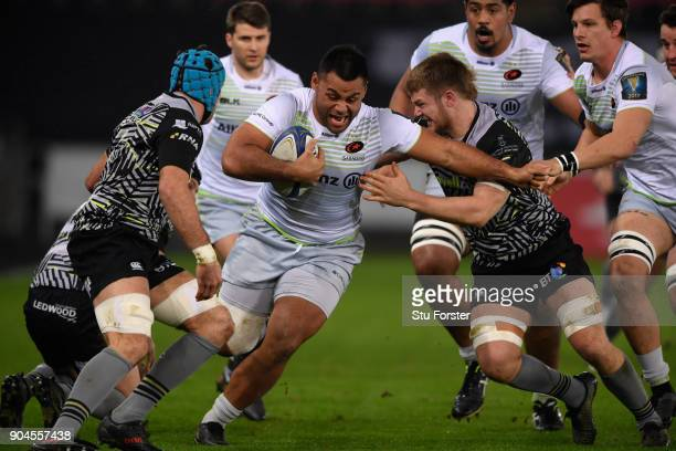 Saracens player Billy Vunipola charges past Olly Cracknell of the Ospreys during the European Rugby Champions Cup match between Ospreys and Saracens...