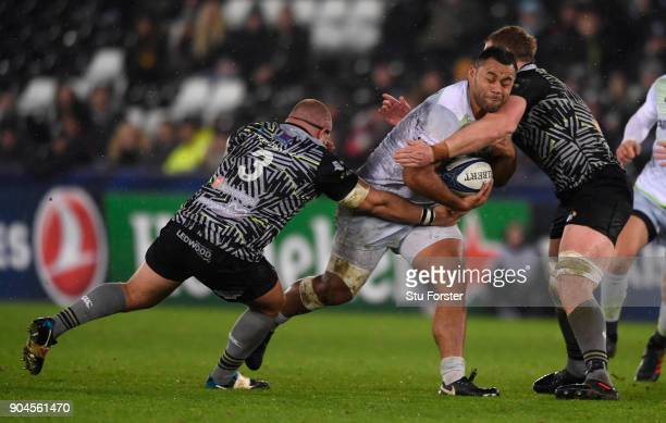 Saracens player Billy Vunipola on the charge during the European Rugby Champions Cup match between Ospreys and Saracens at Liberty Stadium on January...