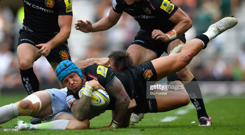 Saracens player Marcelo Bosch tackles Exeter wing Jack Nowell during the Aviva Premiership Final between Exeter Chiefs and Saracens at Twickenham Stadium on May 26, 2018 in London, England.