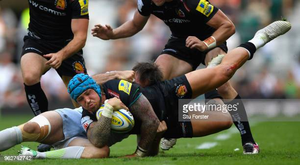 Saracens player Marcelo Bosch tackles Exeter wing Jack Nowell during the Aviva Premiership Final between Exeter Chiefs and Saracens at Twickenham...