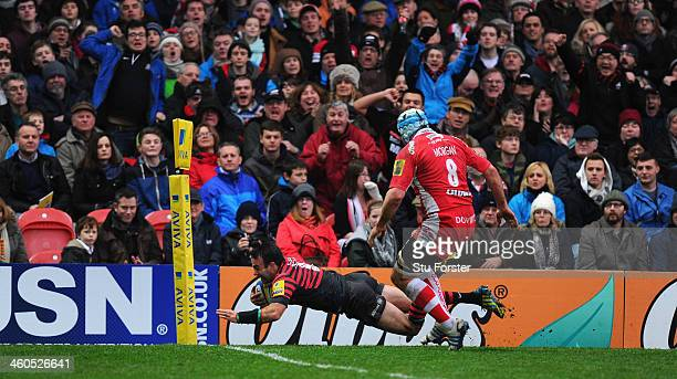 Saracens player Neil de Kock dives over for the first try during the Aviva Premiership match between Gloucester and Saracens at Kingsholm Stadium on...