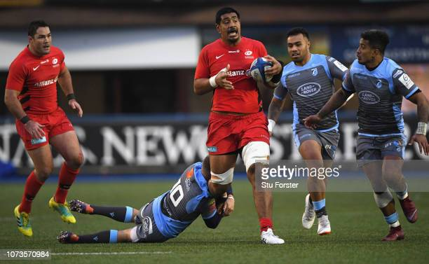 Saracens player Will Skelton is tackled by Gareth Anscombe of the Blues during the Champions Cup match between Cardiff Blues and Saracens at Cardiff...