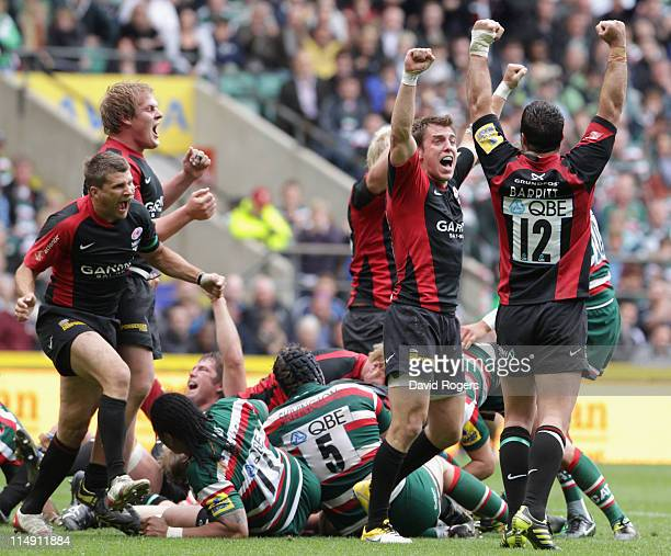 Saracens players celebrate at the final whistle during the AVIVA Premiership Final between Leicester Tigers and Saracens at Twickenham Stadium on May...