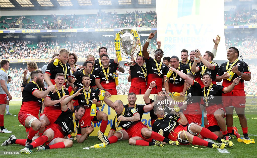 Saracens players celebrate with the trophy after the Aviva Premiership final match between Saracens and Exeter Chiefs at Twickenham Stadium on May 28, 2016 in London, England.