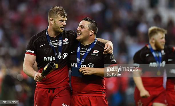 Saracens players George Kruis and Jamie George celebrate after the European Rugby Champions Cup Final between Racing 92 and Saracens at Grand Stade...