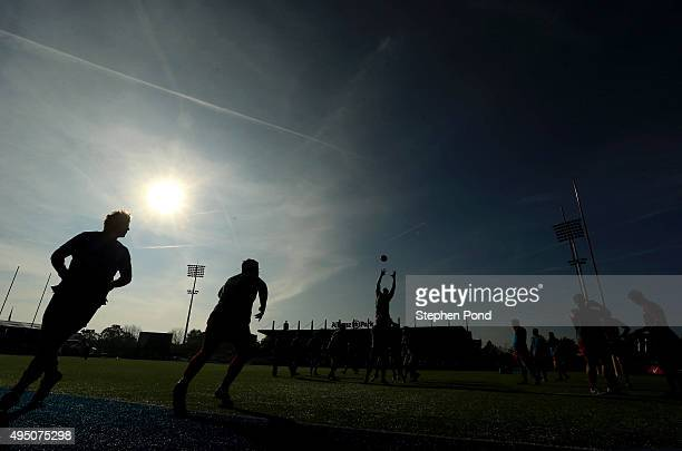 Saracens players warm up ahead of the Aviva Premiership match between Saracens and London Irish at Allianz Park stadium on October 31 2015 in Barnet...