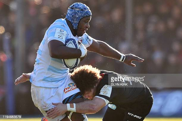 Saracens' Scottish centre Duncan Taylor tackles Racing92's French prop Eddy Ben Arous during the European Champions Cup rugby union Pool 4 match...