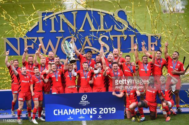 TOPSHOT Saracens' South Africanborn English centre Brad Barritt lifts the trophy as Saracens' players celebrate their win on the field after the...
