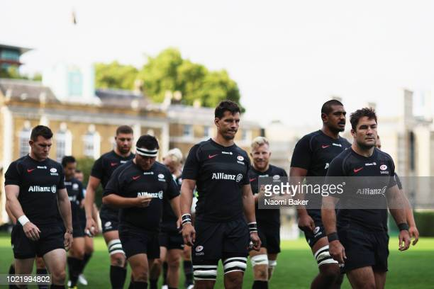 Saracens team walk out onto the pitch prior to the match between Saracens and Ospreys at Honourable Artillery Company on August 23 2018 in London...