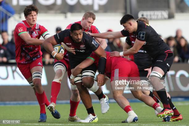 Saracens Will Skelton is tackled by Harlequins Lewis Boyce and George Merrick during the Anglo Welsh Cup match at Allianz Park London