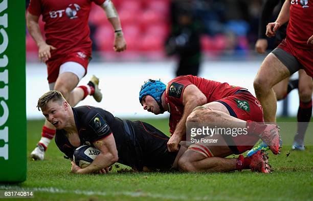 Saracens wing Chris Ashton breaks through to score the third Saracens try during the European Rugby Champions Cup match between Scarlets and Sarcens...