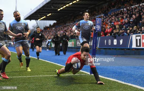 Saracens wing Sean Maitland crosses for the first try during the Champions Cup match between Cardiff Blues and Saracens at Cardiff Arms Park on...
