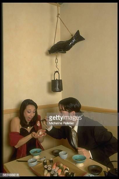 Sarah Abitbol and St{phane Bernardis at a restaurant