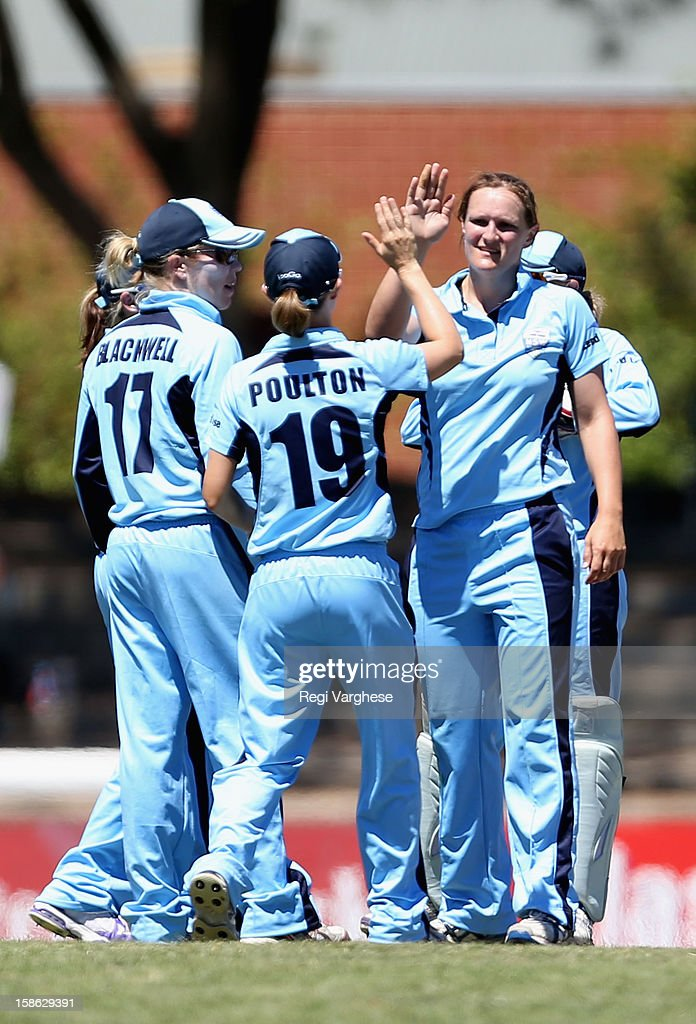 Sarah Aley of Breakers celebrates taking a wicket with team mates during the WNCL match between the South Australia Scorpions and the New South Wales Breakers at Prospect Oval on December 22, 2012 in Adelaide, Australia.