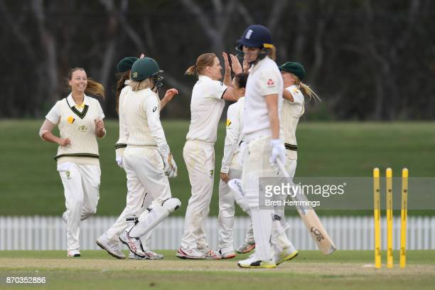 Sarah Aley of CAXI celebrates with team mates after taking the wicket of Natalie Sciver of England during day three of the Women's Tour match between...