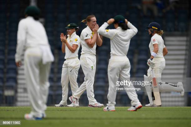 Sarah Aley of CAXI reacts after bowling a delivery during day one of the Women's Tour match between England and the Cricket Australia XI at Blacktown...