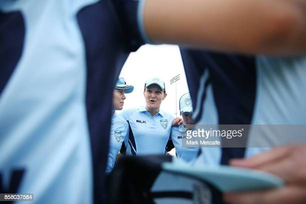 Sarah Aley of NSW talks to team mates before the WNCL match between New South Wales and Queensland at Blacktown International Sportspark on October 6...