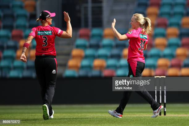 Sarah Aley of the Sixers and Kim of the Sixers celebrate the wicket of Hayley Matthews of the Hurricanes during the Women's Big Bash League match...
