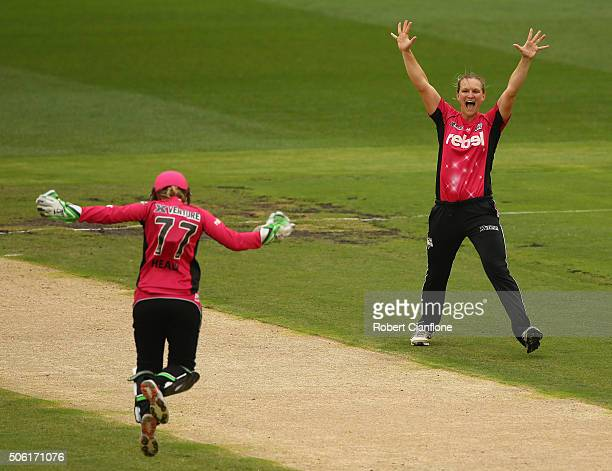 Sarah Aley of the Sixers celebrates with Alyssa Healy after the combined to take the wicket of Hayley Matthews of the Hurricanes during the Women's...