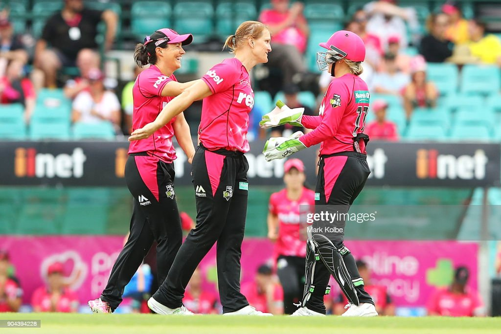 Sarah Aley of the Sixers celebrates with her team after taking a wicket during the Women's Big Bash League match between the Sydney Sixers and the Sydney Thunder at Sydney Cricket Ground on January 13, 2018 in Sydney, Australia.