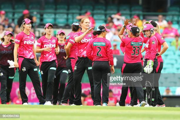 Sarah Aley of the Sixers celebrates with her team after taking a wicket during the Women's Big Bash League match between the Sydney Sixers and the...