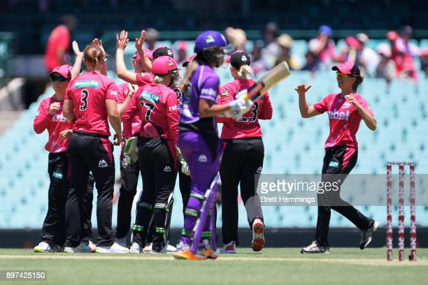Sarah Aley of the Sixers celebrates with team mates after taking the wicket of Hayley Matthews of the Hurricanes during the Women's Big Bash League...