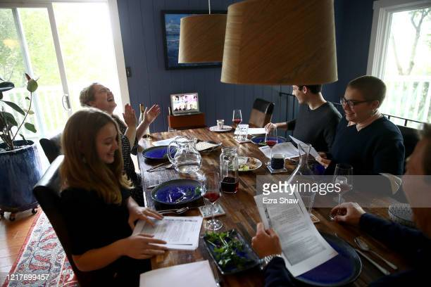 Sarah and Aaron Sanders celebrate a Passover Seder with their children Noah Bella and Maya at home and different family members across the country...