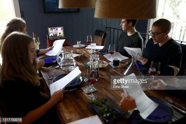 Sarah and Aaron Sanders celebrate a Passover Seder with their children Noah Bella 18 and Maya at home and different family members across the country...
