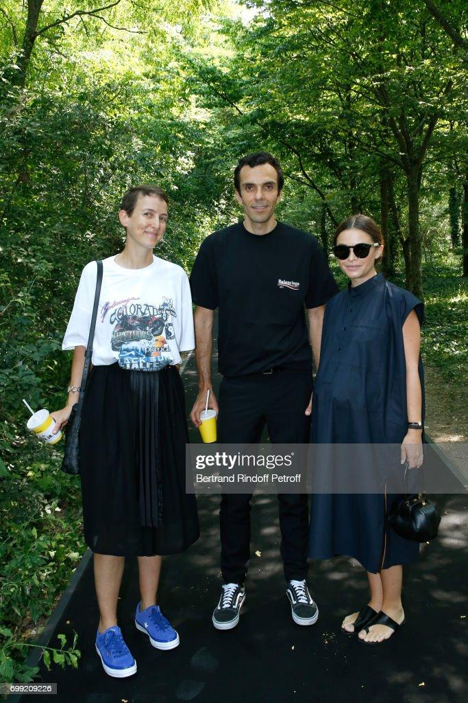 Sarah Andelman of Colette, CEO Balenciaga Cedric Charbit and Miroslava Duma (pregnant) attend the Balenciaga : Menswear Spring/Summer 2018 show as part of Paris Fashion Week on June 21, 2017 in 'Bois de Boulogne', Paris, France.