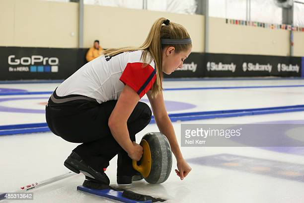 Sarah Anderson of USA prepares to deliver her stone against Canada in the Curling Mixed Doubles Finals during the Winter Games NZ at Naseby Curling...