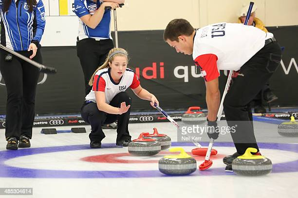 Sarah Anderson of USA talks to the stone delivered by her partner Korey Dropkin in the Curling Mixed Doubles Semi Finals during the Winter Games NZ...