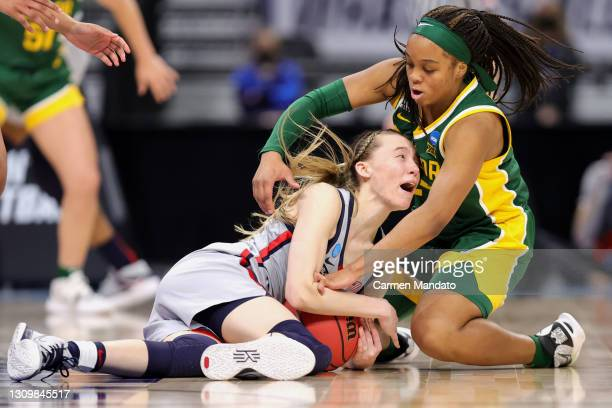 Sarah Andrews of the Baylor Lady Bears battles Paige Bueckers of the UConn Huskies for the ball during the second half in the Elite Eight round of...
