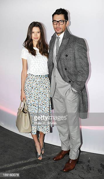Sarah Ann Macklin and David Gandy attend the JW Anderson show at the London Collections MEN AW13 at The Old Sorting Office on January 9 2013 in...