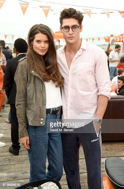 Sarah Ann Macklin and Isaac Carew attend the Aperol Spritz Social on July 13 2017 in London England