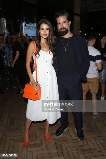 Sarah Ann Macklin and Jack Guinness attend Adam Nathaniel Furman's 'Chromacolour Catwalk' for Artist Playground by Pullman on June 28 2018 in London...