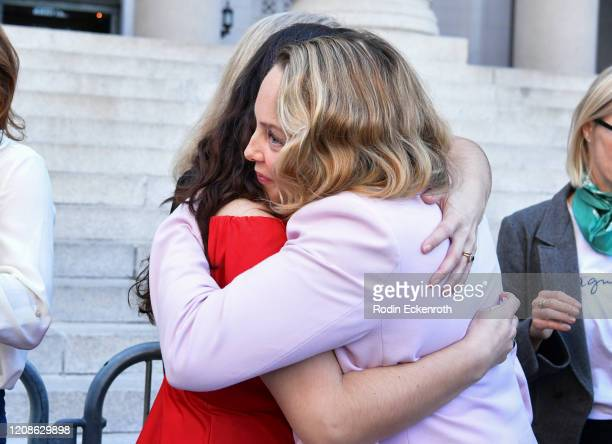 Sarah Ann Masse and Louisette Geiss hug at Silence Breakers Hold Press Conference In Los Angeles Following Guilty Verdict In Harvey Weinstein Trial...