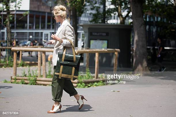 Sarah Ann Murray carries a bag by Robert Spangle The Observer collection during Paris Men's Fashion Week SS17 on June 23 2016 in Paris France