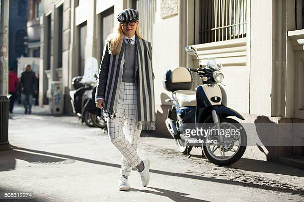 Sarah Ann Murray of The Rake wears a bespoke trousers and pants and a Drakes scarf during the Milan Men's Fashion Week Fall/Winter 2016/17 on January...
