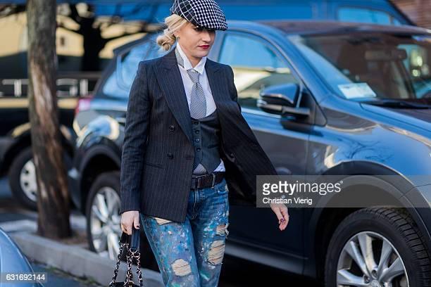 Sarah Ann Murray wearing a checked flat cap striped blazer ripped denim jeans vest seen at Diesel during Milan Men's Fashion Week Fall/Winter 2017/18...