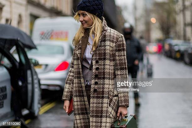 Sarah Ann Murray wearing a plaid wool coat and a navy knit cap seen outside Julien Macdonald during London Fashion Week Autumn/Winter 2016/17 on...