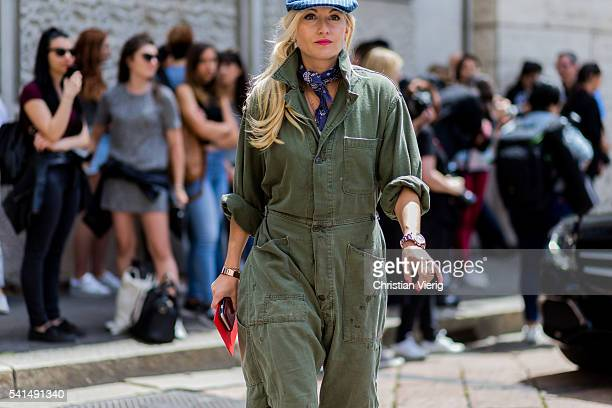 Sarah Ann Murray wearing an olive overall and hat outside Ferragamo during the Milan Men's Fashion Week Spring/Summer 2017 on June 19 2016 in Milan...