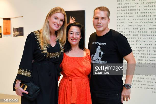 Sarah Arison Amanda Fairey and Shepard Fairey attend the National YoungArts Foundation Miami Art Week Supper Club at YoungArts on December 3 2018 in...