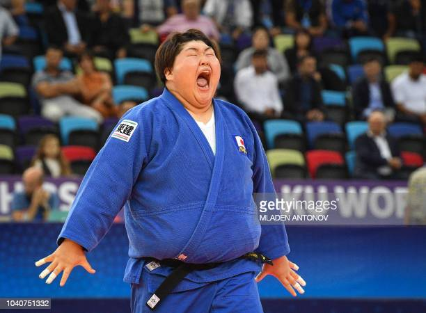 TOPSHOT Sarah Asahina from Japan stretches during the women's over 78kg category bouts of the 2018 Judo World Championships in Baku on September 26...