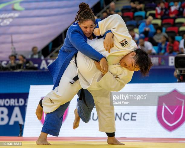 Sarah Asahina of Japan attacks Kayra Sayit of Turkey eventually winning the o100kg quarterfinal by an ippon to be in the semifinal during day seven...