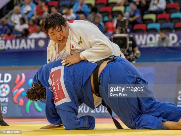 Sarah Asahina of Japan throws Kayra Sayit of Turkey for a wazari eventually winning the o100kg quarterfinal by an ippon to be in the semifinal during...