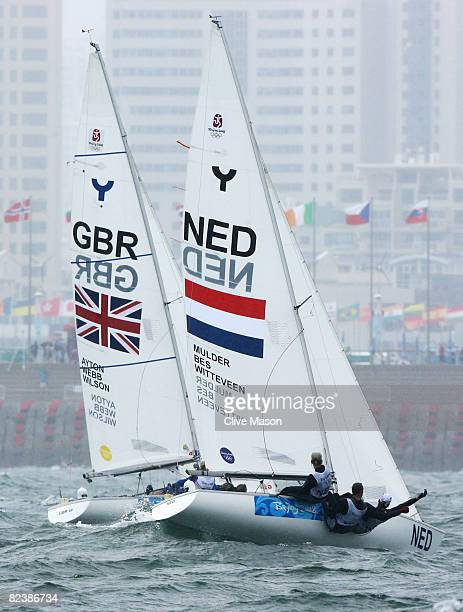 Sarah Ayton Sarah Webb and Pippa Wilson of Great Britain and Mandy Mulder Annemieke Bes and Merel Witteveen of Netherlands compete in the Yngling...